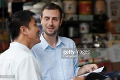 Stock Photo : asian and european businessmen in street