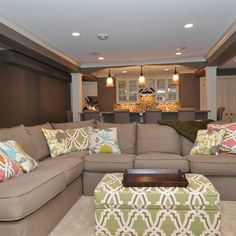neutral sectional with bold print ottoman. Love! And what if the couch faced the stairway with play room behind? Hmmmm