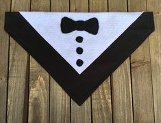 Let your pet showoff his sophisticated side this New Year with a Tuxedo Bandana. The bandana is made with black fabric and white and black felt trim. The bandanas are made of quality cotton/cotton blend fabric, felt and polyester thread. They have been hand cut and sewn with the