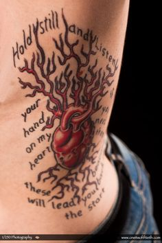 """""""This is my biggest piece to date, and it runs down the left side of my rib cage. The words are from the astronautalis song, """"The River, The Woods"""" and read """"Hold still, and listen, your hand on my heart, if you need them these beacons will lead you back to the start."""" His music really means a lot to me, and I started his street team to help him out. / I got this from Dag Caron at Laughing Buddha Tattoo in Seattle, WA."""""""