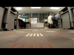 An Autoweek editor drives a RC Mustang through the office!
