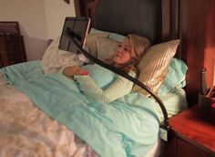 The Right Arm can hold your laptop or tablet in a variety of configurations, including angled downward.