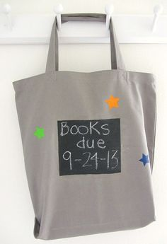 This tote will (hopefully) keep you from ever having overdue library fees again: you can write the due date on the side in chalk. Library Bag, Library Books, Chalkboard Paint, Chalkboard Fabric, Chalk Paint, Book Club Books, Canvas Bags, Canvas Book Bag, Book Lovers