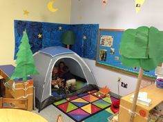 Preschool camping theme for classroom. I put up a tent, added a picnic table, picnic basket, lanterns, flashlights, fake campfire, and a starry night!