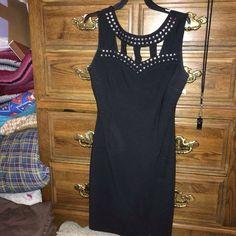 NWT Black Dress Brand new dress!!!! Tags still intact!! Fits like a size 4/6 due to it's stretchy quality Dresses Mini