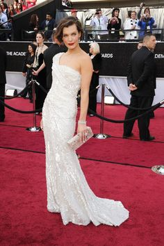 Milla Jovovich - Elie Saab dress, Jacob & Co. jewelry, and an Edie Parker clutch - 84th Annual Academy Awards.