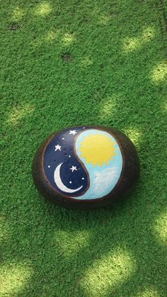 Ying-Yang, day and night painted on a Lake Huron beach stone by Cindy P 2017