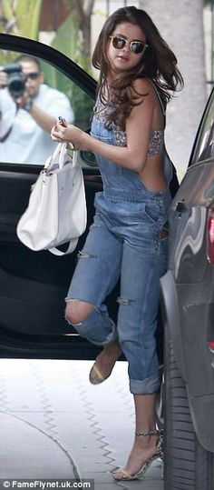 Canadian tuxedo: Selena Gomez wore two denim looks at the Sunset Tower hotel on Saturday in west Hollywood, California