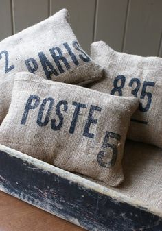 Cute burlap pillows. I have burlap bags. Where are my stencils? Follow me for great DIY decor projects!!