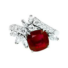 Raymond Yard Burma Ruby No Heat Ring. A cushion cut vivid red burmese (no heat) ruby weighing carat accented with round briliant and marquise diamond spray set in Platinum.