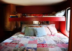 RV/Trailer Makeover:  I've never thought of red as restful color but it does transform this space and the comfy, quilt tones it down a bit.