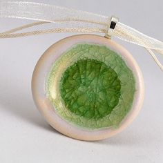 Ceramic pendant with melted glass center. From Etsy.