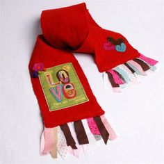 A scrappy love scarf is a great way to use up those random scraps of fabric lying around.