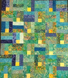 Batik quilt, blues and greens. I've only just discovered batik for quilt making. It's wonderful - has a sort of movement and inner glow.