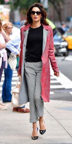 Amal Clooney Is a Flawless Pattern Mix Master in N.Y.C. She donned black and white gingham ankle pants and a black pullover sweater, which she topped with a  long red and gray floral brocade coat. Clooney accessorized with a pair of pointy-toe slingbacks, a cream leather bag,drop earrings and dark shades.