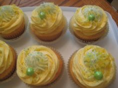 Lemon Lime~ Lemon Cupcake filled with Lime Cream and topped with a Lemon Cream Cheese Frosting and a dallop of Lime Cream! <3