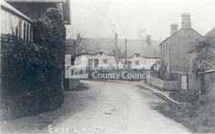 Cooper's Cottages, East Langton, 1910-1920.   East Langton lies 3 miles to the north east of Market Harborough. This images is a copy photograph of a postcard showing two women stand outside Cooper's Cottages, which are the whitewashed thatched dwellings. East Langton is first recorded as Langetone meaning a long settlement. Woman Standing, Leicester, Family History, Cottages, The Outsiders, Architecture, Photography, Painting, Image