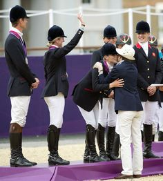 After placing the medal around Zara's neck, Princess Anne pulled her daughter close for a kiss on the cheek, as the young equestrian royal appeared to mouth: 'Oh, Mum