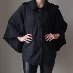 Sandro studio Cape Stay warm with this gorgeous cape by Sandro! Front button closure with 2 pockets. Fully lined. 50% wool 50% viscose. Sandro studio Jackets & Coats Capes