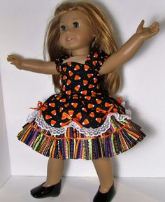 18 Doll Clothes guaranteed to please the little girl in your life...  Mia is modeling a One of a Kind Party Dress Set. It is newly created in my pet and smoke free sewing studio. The seams are backstitched and finished for added durability.  This handmade outfit includes 2 pieces: -A cute candy corn print cotton party dress has coordinating striped print cotton underskirt trimmed with fabric ruffles. Cap sleeves have elastic for comfortable fit, bodice is fully lined and scalloped overskirt…