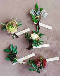 mismatched boutonnieres tied with velvet ribbon