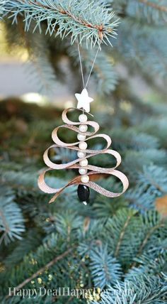 Nadire Atas on the Christmas Season Learn how to make a Homemade Essential Oil Diffuser Christmas Tree Ornament out of lava beads, pearl beads and ribbon + Pine Essential Oil! Homemade Essential Oil Diffuser Christmas Tree Ornament - this is great for any Rustic Christmas Ornaments, Christmas Holidays, Ornaments Ideas, Homemade Ornaments, Diy Christmas Tree Decorations, Homemade Christmas Tree Decorations, Christmas Ribbon Crafts, Christmas Carol, Christmas Lights
