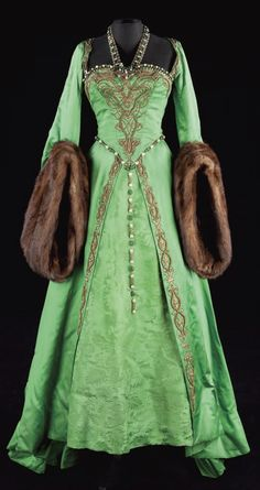 Green Tudor-era gown with fur-trimmed sleeves.: