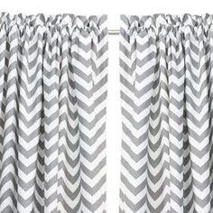 Topstitched cotton curtain panel with a chevron motif. Made in Council Bluffs, Iowa.   Product: Curtain panelConstruction Material: 100% Cotton Color: White and ash greyFeatures:  TopstitchedMade in Council Bluffs, Iowa Note: Image depicts two curtain panels, but price is for one Cleaning and Care: Hand or spot clean