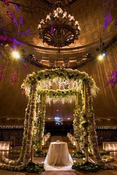 game of thrones wedding...This chuppah overflowing with greenery lends a mystical vibe to an urban venue