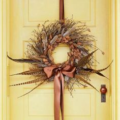 13 welcoming wreaths for fall (Love this one with the pheasant feathers!) | Living the Country Life | http://www.livingthecountrylife.com/homes-acreages/country-homes/13-welcoming-wreaths-fall/