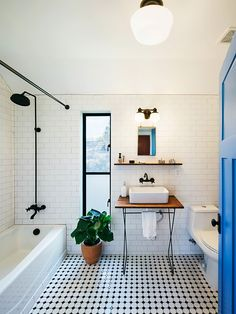 Black and White bathroom interior decoration. Exquisite bathroom uses a simple black and white color scheme [From: Pavonetti Design] Interior, White Floors, Kitchen And Bath, Small Bathroom Decor, White Subway Tile, Bathrooms Remodel, Bathroom Decor, Bathroom Inspiration, Tile Bathroom