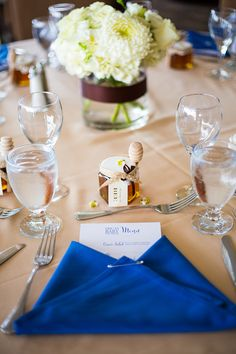 You're Welcome Events Baby Shower at SeaCliff Country Club in Huntington Beach, CA. Diaper napkin fold with menu insert. Honey jar and dipper party favor. Royal Blue, Cream, Khaki
