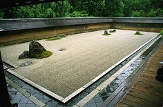The famous and timeless rock garden of the Ryoan-ji Temple, Kyoto, Japan.  This temple was constructed in the 1400s but looks modern, spartan and timeless.