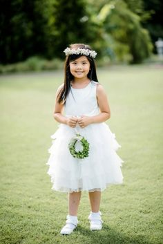 The sweetest flower girl carrying a boxwood wreath! | Caroline Lima