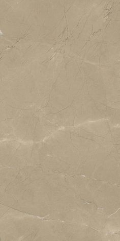 The bronze hue becomes lighter and lighter, without losing its softness; the black and white veins across the surface appear elegant and enveloping, like the gathering of fabric in a beautiful dress.  Noble Ecru from Marble Lab.