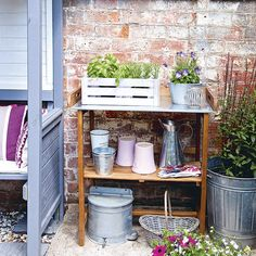 Courtyard garden with with potting shelf | Kitchen design ideas | PHOTO GALLERY | Garden decorating | Idealhome.co.uk