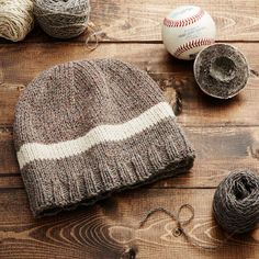 This unique beanie is knit from the wool yarn found inside MLB game-used baseballs.