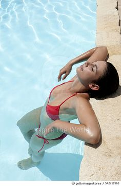 Young woman relaxing in pool - gettyimageskorea