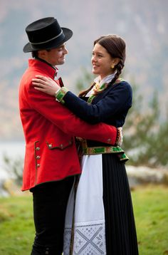 Folk costumes from hardangerfjord  The girl´s jacket, in dark blue wool and silk edging, is an original from the museum collection. Her plaited hair and the embroidered belt indicates that she is not married.