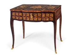 Lady's make-up or dressing table, Louis XV period, circa 1765/70, stamped J. L. COSSON (Jacques Laurent Cosson, maître from 1765). Made in various softwoods and hardwoods, with rosewood and tulipwood veneer, also richly decorated with marquetry in various partly dyed fine woods depicting flowers, musical instruments and cube patterning. With 2 drawers at the front, a pull-out extension ledge with later lining. Wien, Dorotheum, 22.04.15, no. 524.