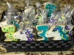 Unicorn and #3 basket full of decorated cookies