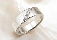 men's wedding band with channel-set diamonds in palladium 950. $1,511.00, via Etsy.
