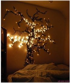pretty wall tree strung with Christmas lights!