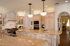 Light Granite, antique white kitchen cabinets, stove hood