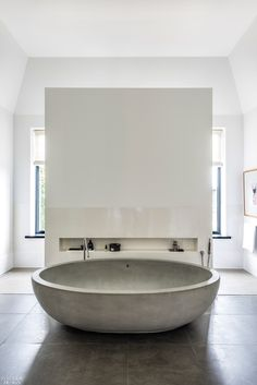 Pietra Serena paves the floor of the master bathroom, which centers on a Boffi soaking tub. Deep Soaking Tub, Soaking Tubs, Small Bathroom, Master Bathroom, Bathrooms, Contemporary Bathtubs, Amsterdam, Boffi, Rustic Bathroom Designs