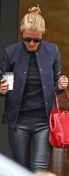 Who made  Gwyneth Paltrow's red studded handbag and blue leather sleeve jacket?