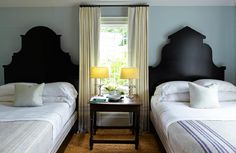 Pair of coordinated--but not identical--shapely wood headboards (room designed by Steven Gambrel)