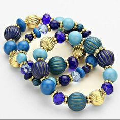 Sapphire blue & gold beaded bracelet set NWT Trendy gold tone and hues of blue beaded bracelets. Set of three. Fits wrist 7 to 7.5 perfectly. Bramd new with tag. Great quality and design. Jill.Marie Boutique Jewelry Bracelets