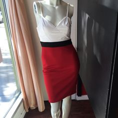 Red & White Color Block Dress Adjustable spaghetti strap Red, White & Black color block mini dress.  White bustier top is faux leather.  Dress features an exposed full length zipper in back.  Dress is 95% Polyester/5% Spandex.  There is a lot of stretch on the bottom to this dress.  Great for Valentine's Day! Dresses Mini