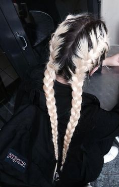 Twin schoolgirl braids on dyed hair.